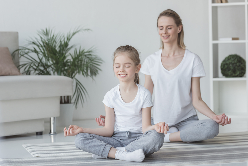 mom teaching mindfulness to her daughter