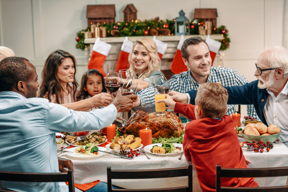 large family enjoying a traditional holiday meal